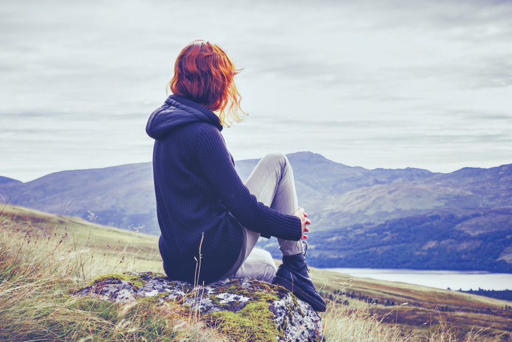 bigstock-Woman-Relaxing-On-Mountain-Top-58334066.jpg