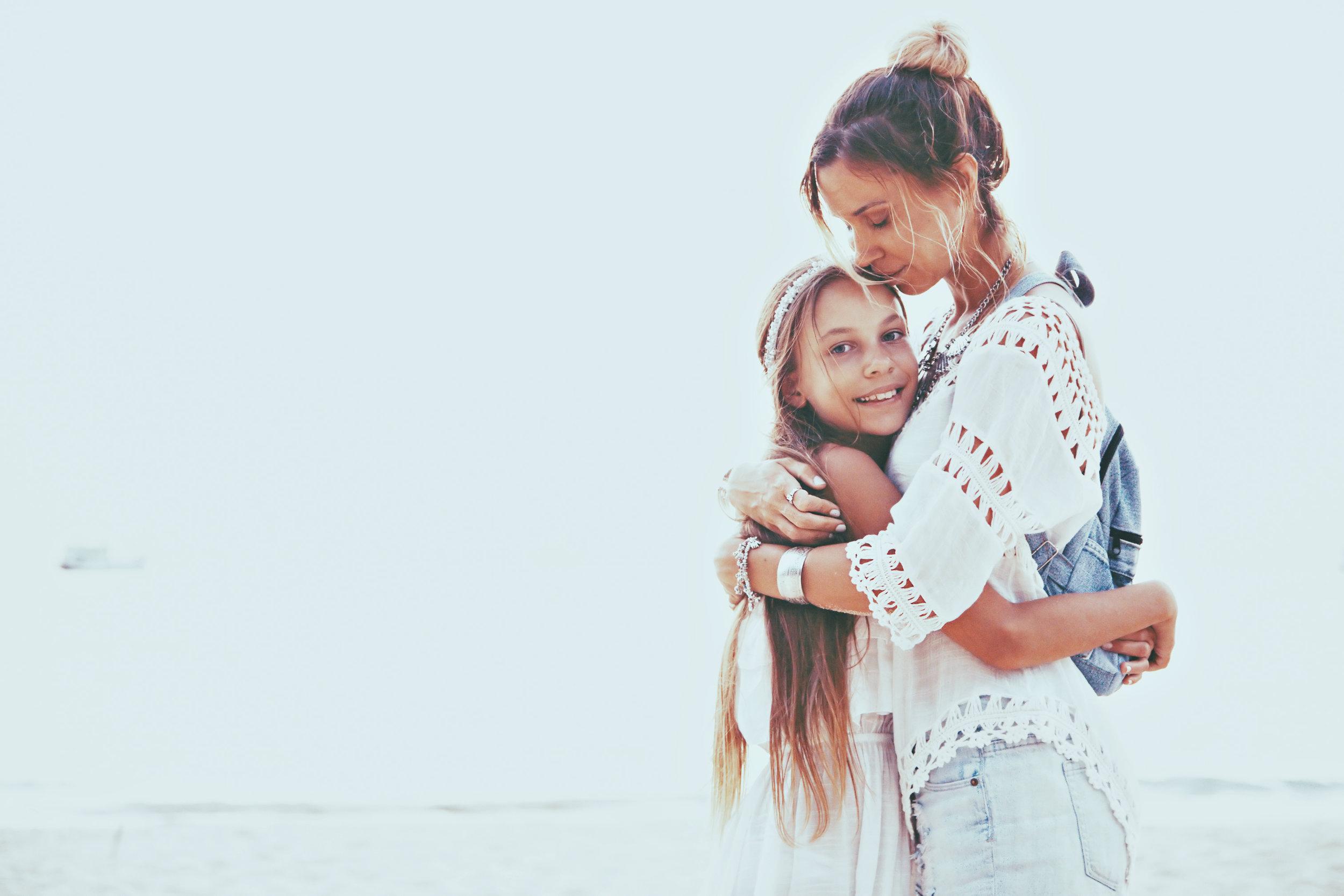 bigstock-Tween-daughter-hugging-with-he-120914501.jpg
