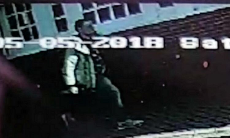 A CCTV image of the suspect - the man is described as white, aged in his twenties, between 5ft 6in and 5ft 8in, slim with dark hair and was wearing jeans and beige jacket.