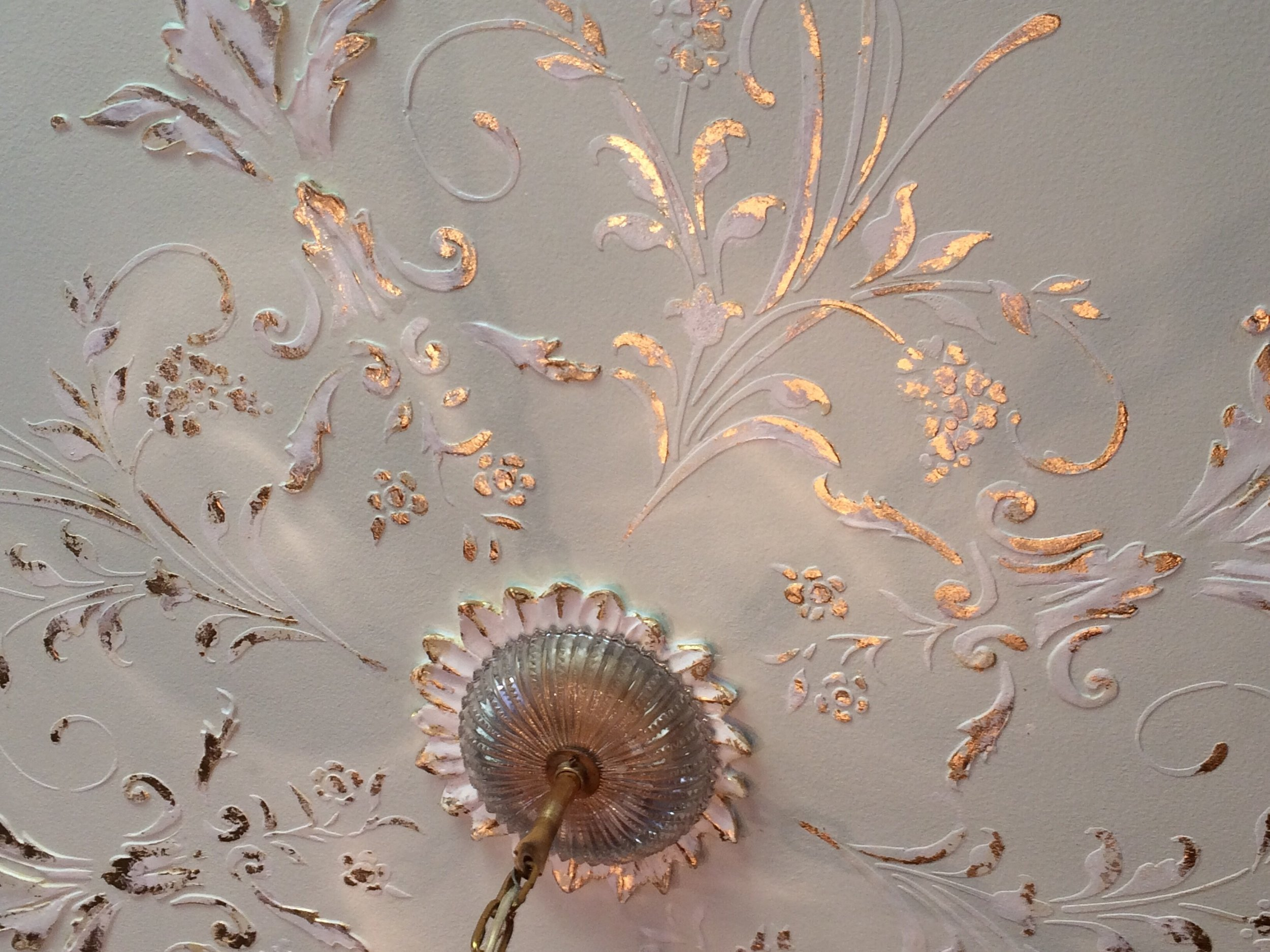 Raised plaster ceiling medallion with gold leaf