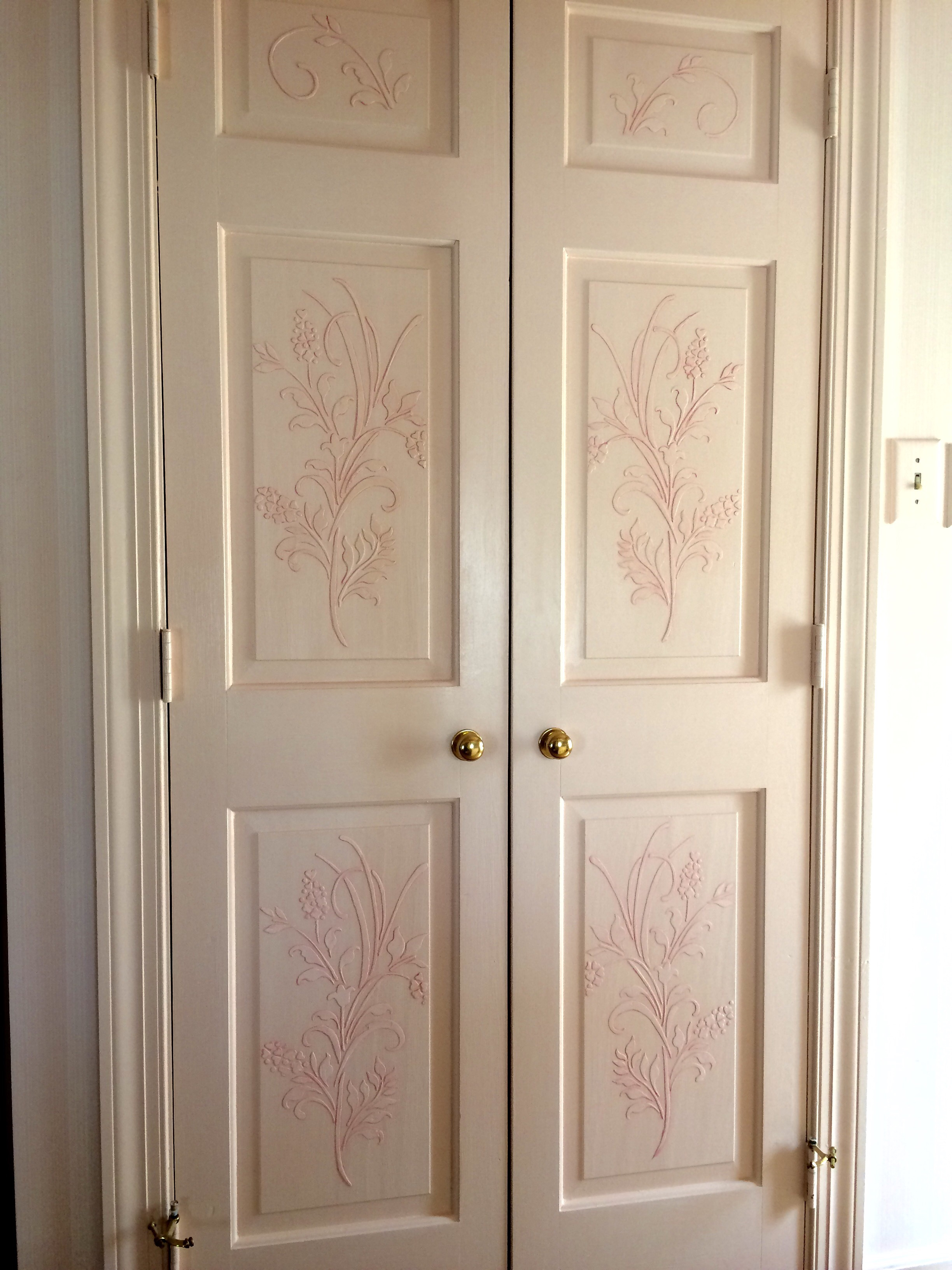 Plaster relief stencil application for bedroom doors