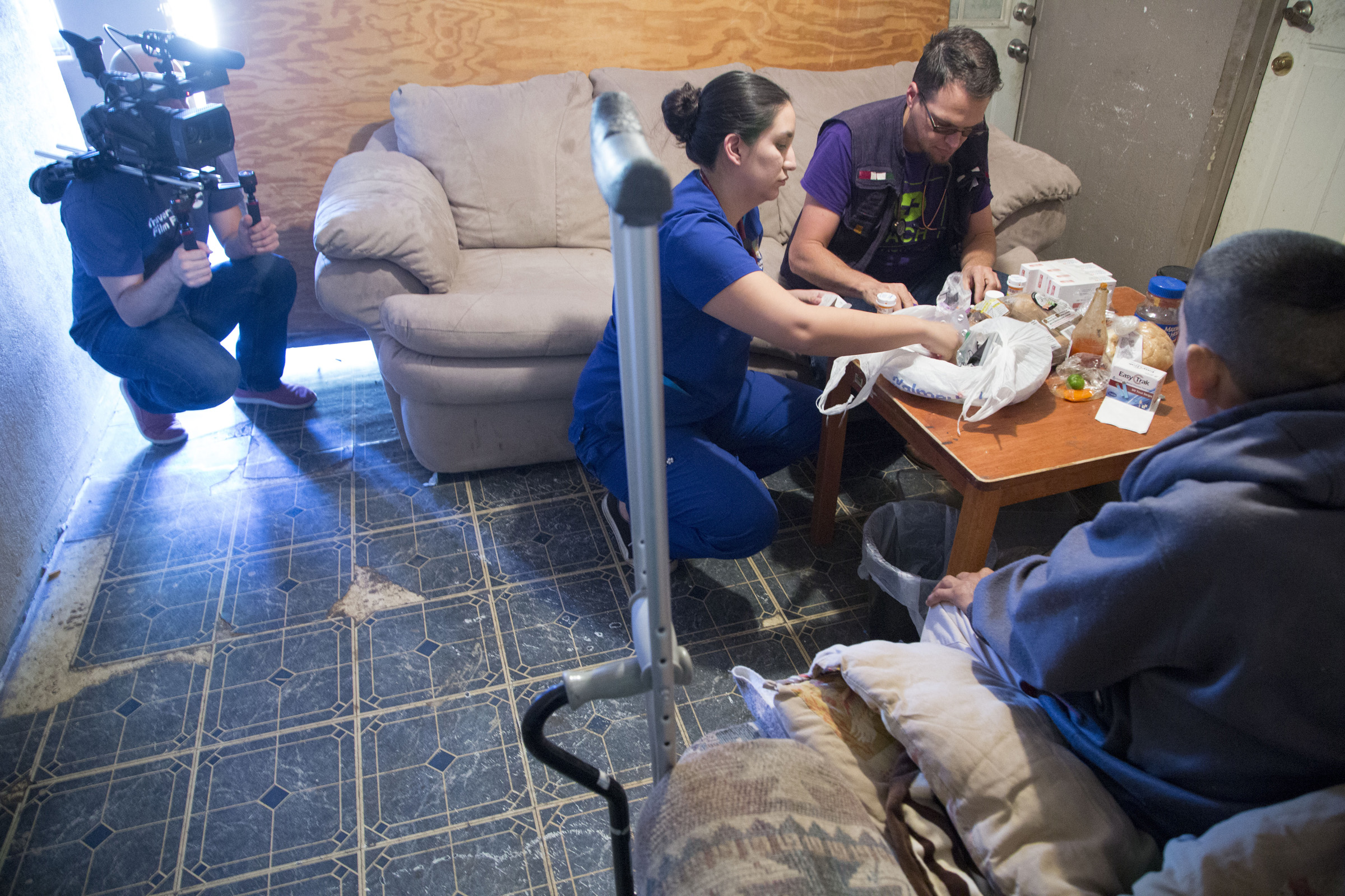 Courtesy of Nick Oza, this picture captures nurses Jason Odhner and Maria Haley on a home visit with a diabetic patient.