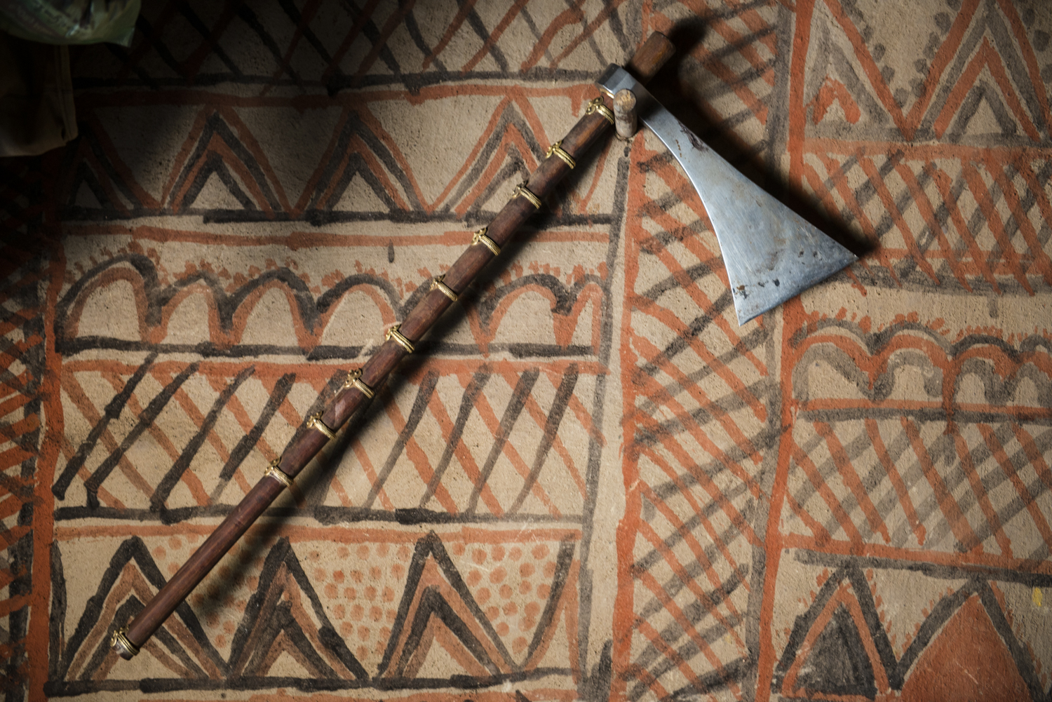 "An axe - ""tangia"" in kui, the kondh dialect - hangs on the interior wall of a kondh house in tahali village, muniguda block, rayagada district.  © karan kumar sachdev December 2014."