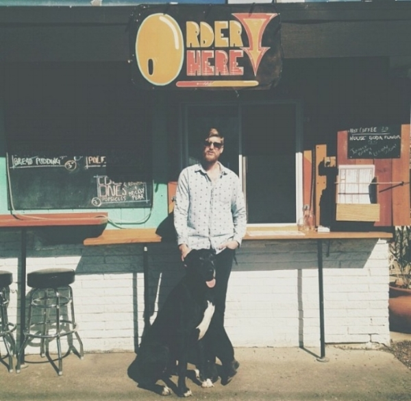 Taylor and his Great Dane, Banksy outside of his old restaurant in Austin, TX.