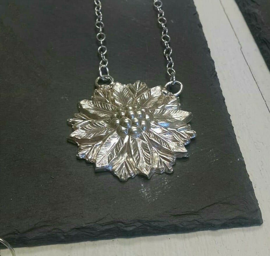 This beautiful piece was cast from a jewelry part made by an old RI manufacturer in the Victorian era. Jessica found the original piece at a flea market then cast it into silver!