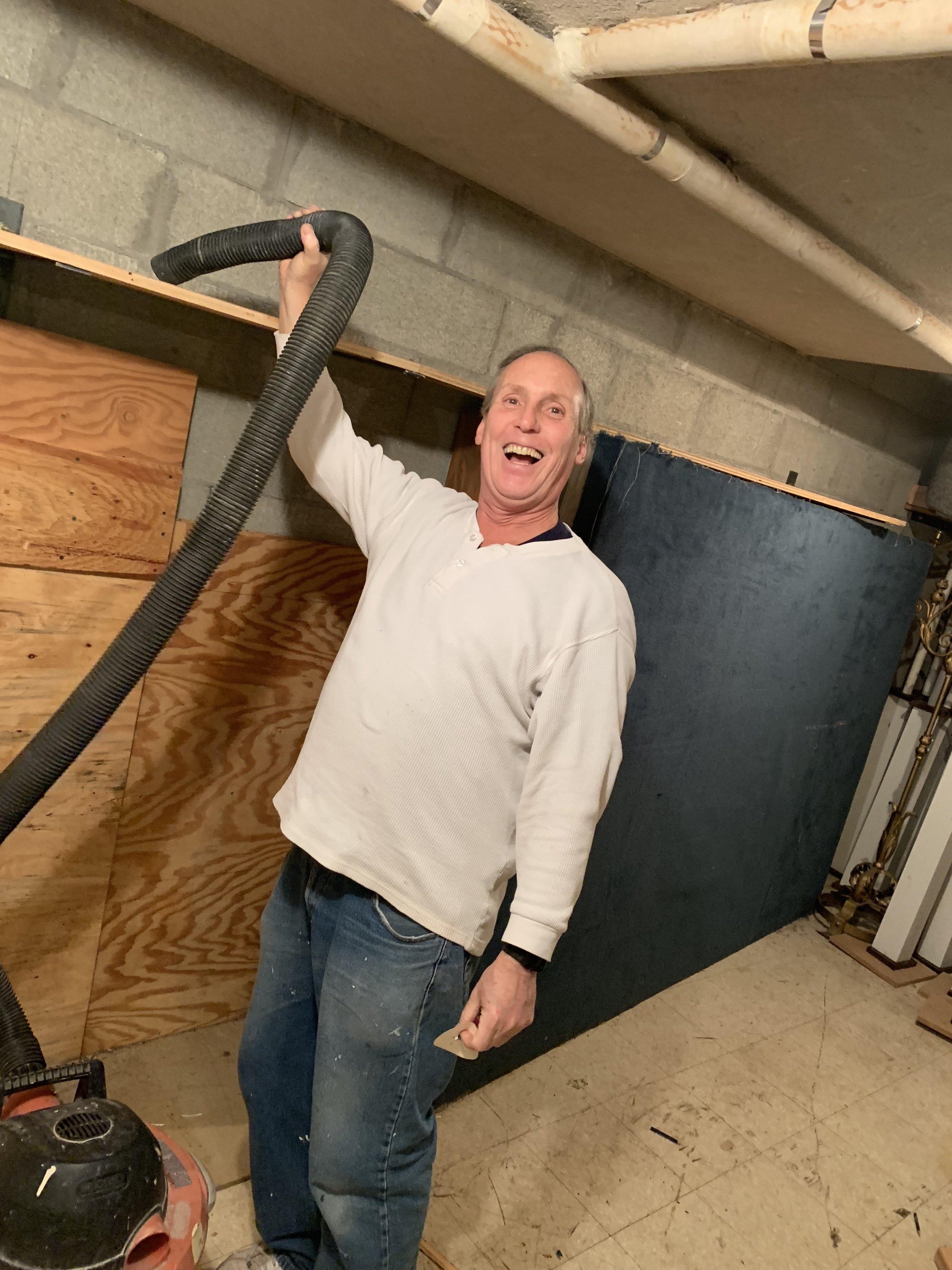 John Cleaning Closet.jpg