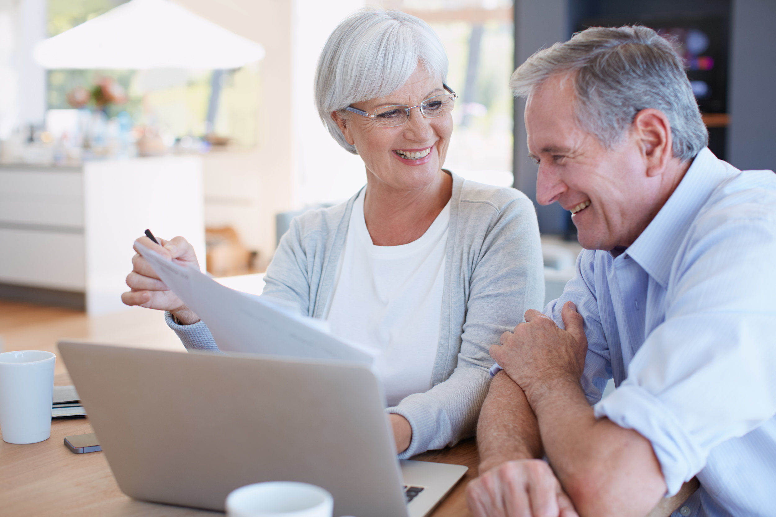 Couple with Papers Sitting at Computer_iStock-495809094.jpg