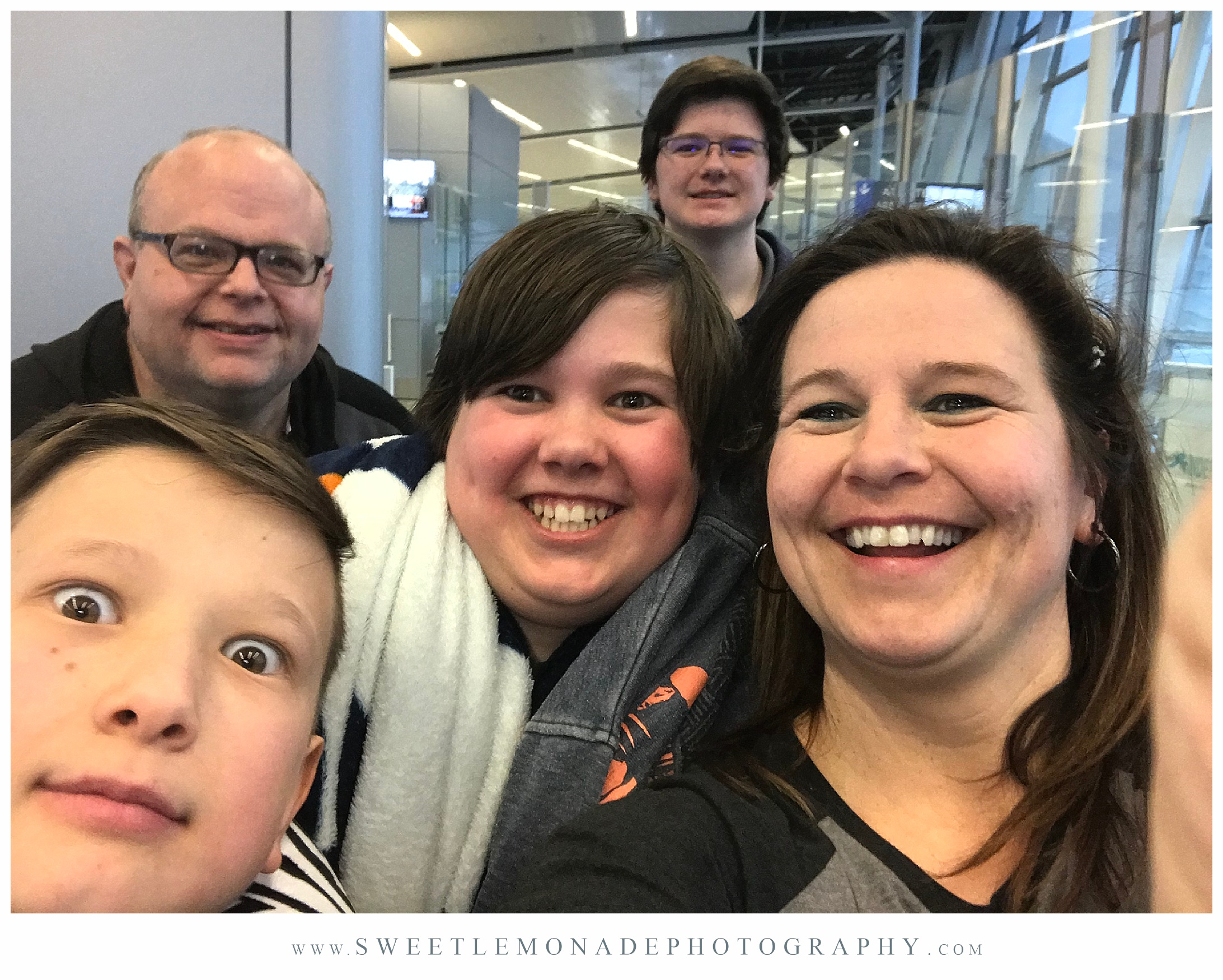 Cell selfie at the airport on our way to see our mom and grandma.