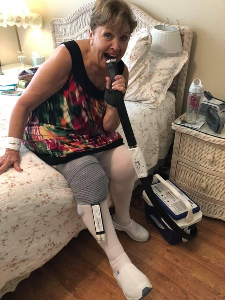 Mom goofing around with her ice machine post surgery.