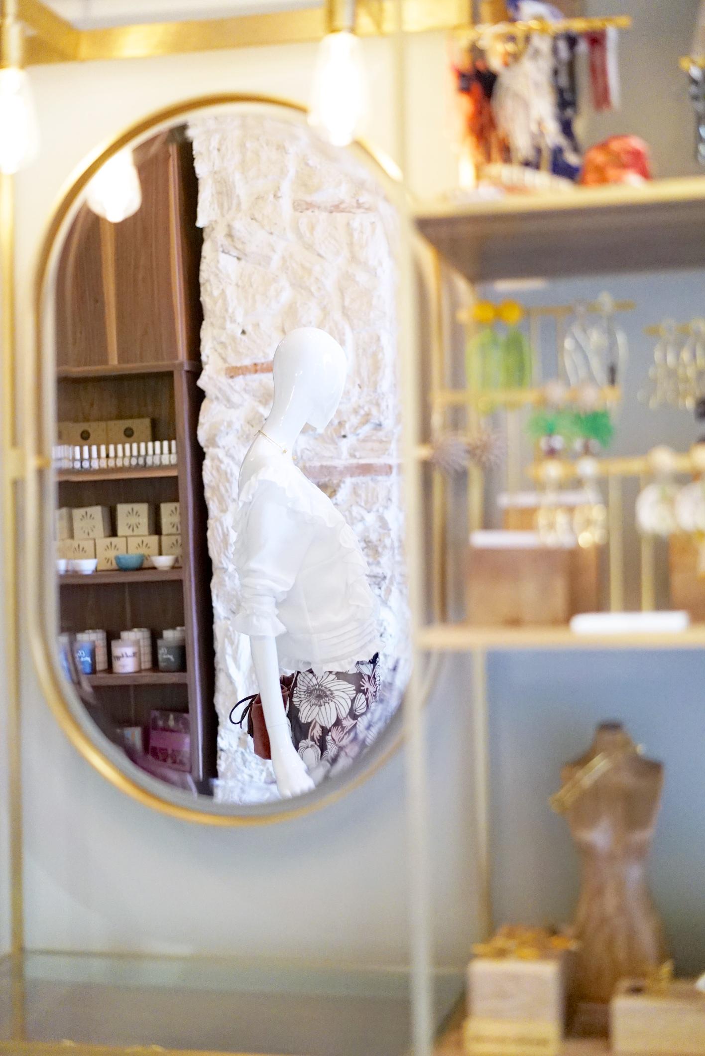 In the reflection, resort wear by  Daniella Batlle .