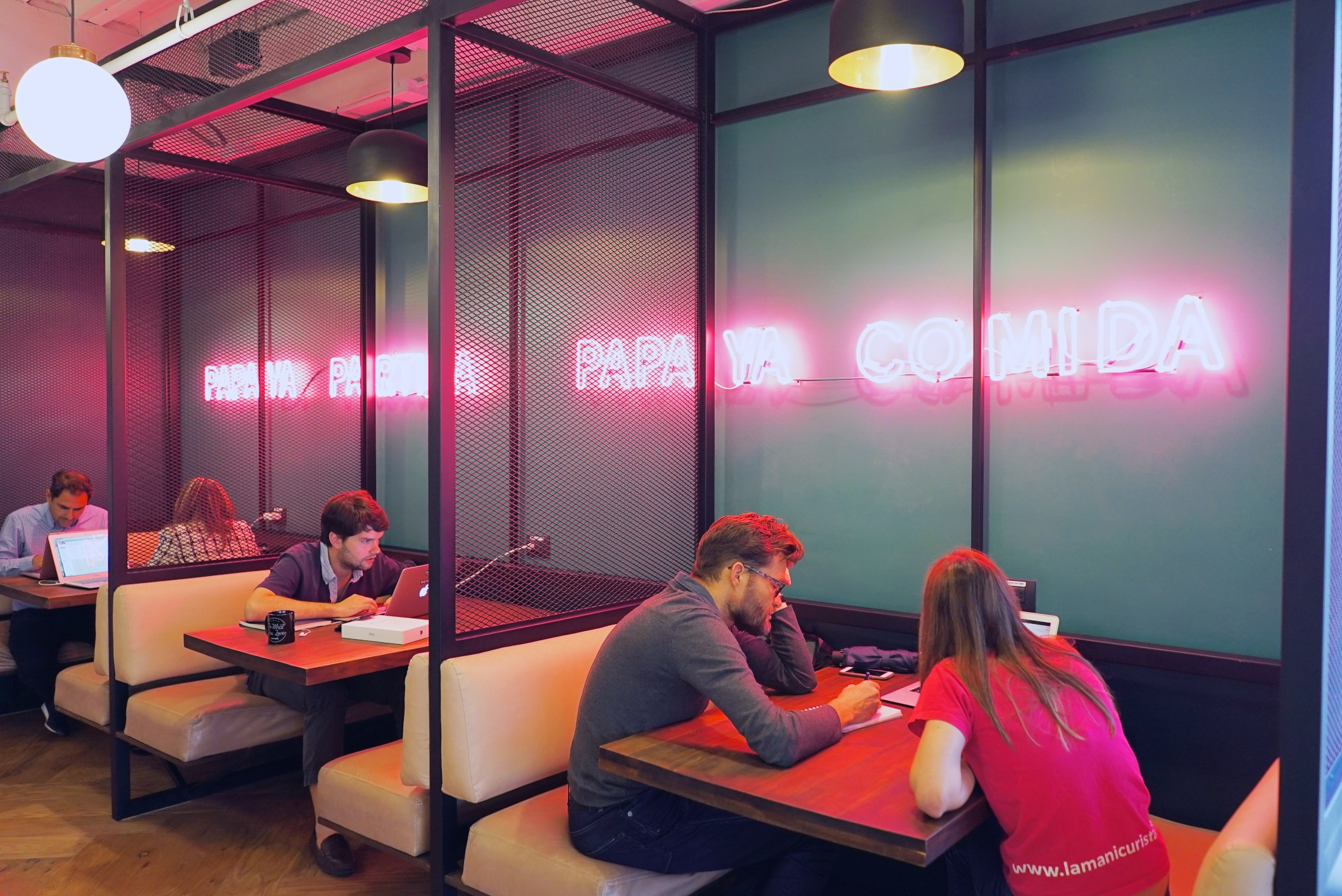 The signature WeWork nooks allow for collaboration or solitary work.