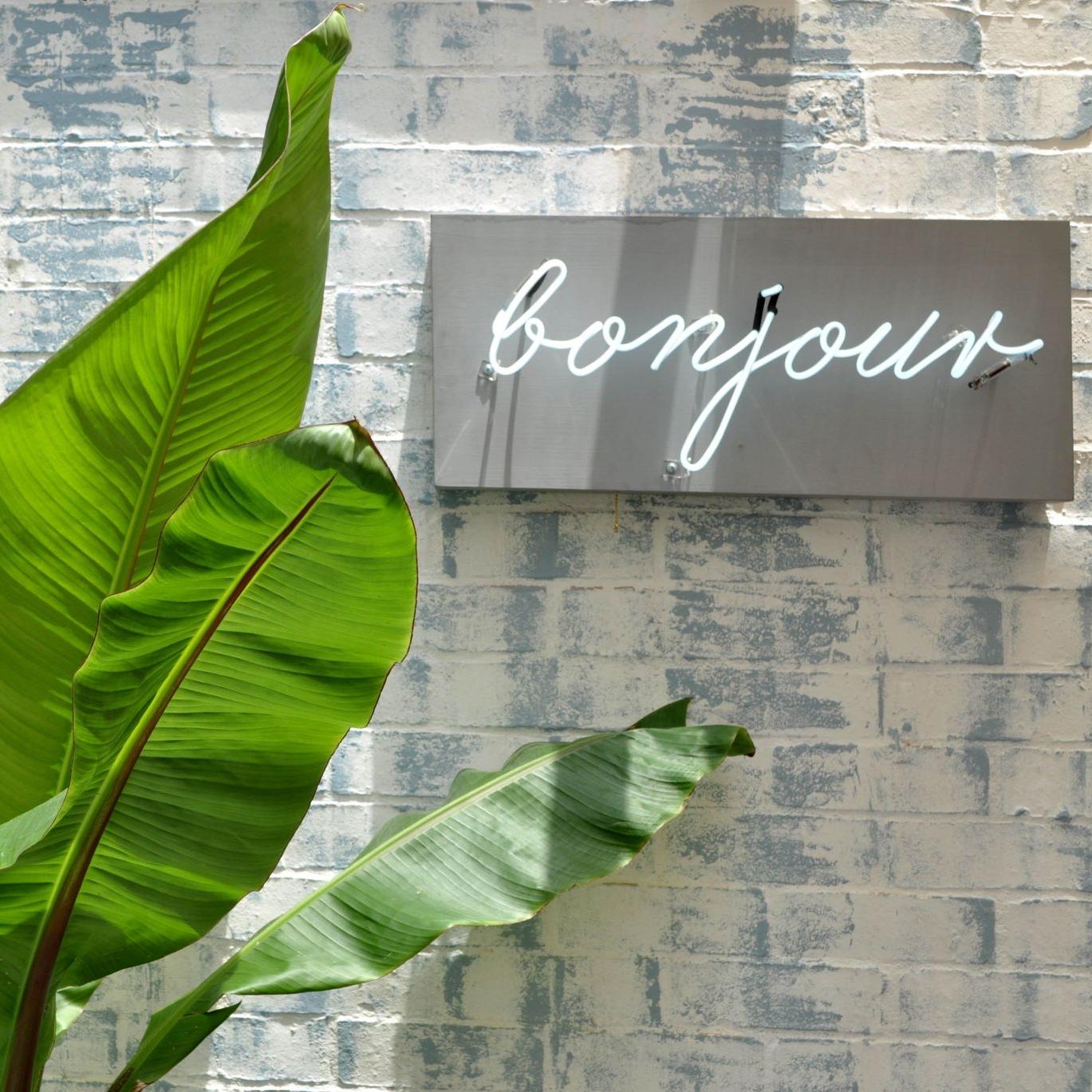 Signage at Bianca & Latte by  Studio Manrique .