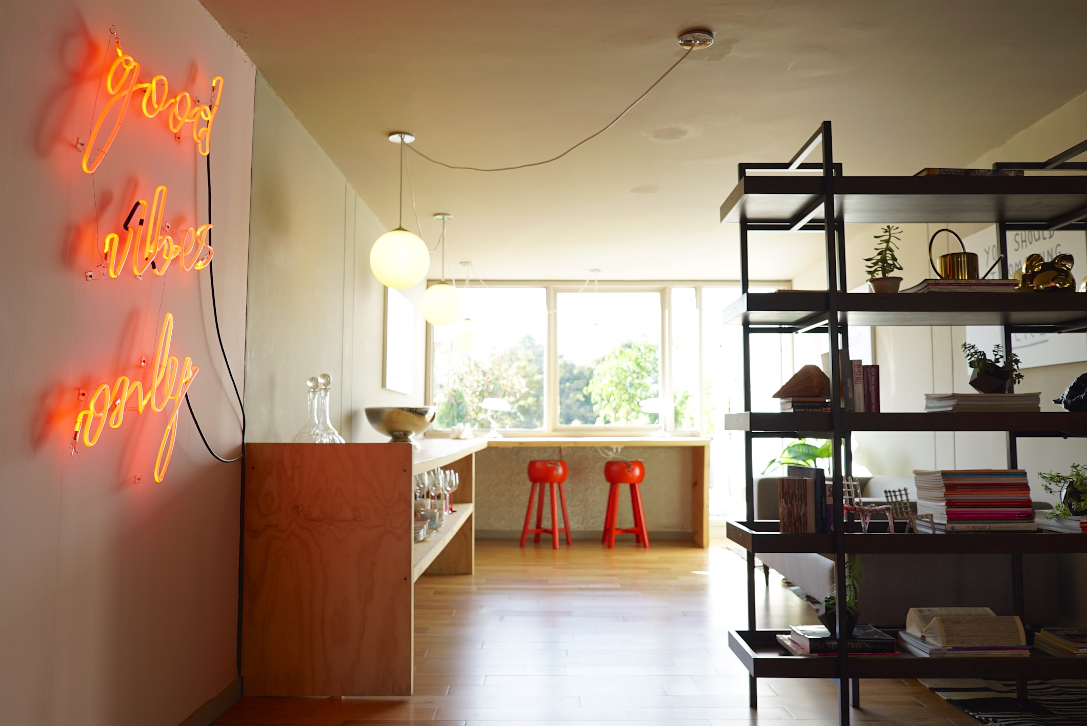 The snack bar is characterized by wood tones and pops of bright red.