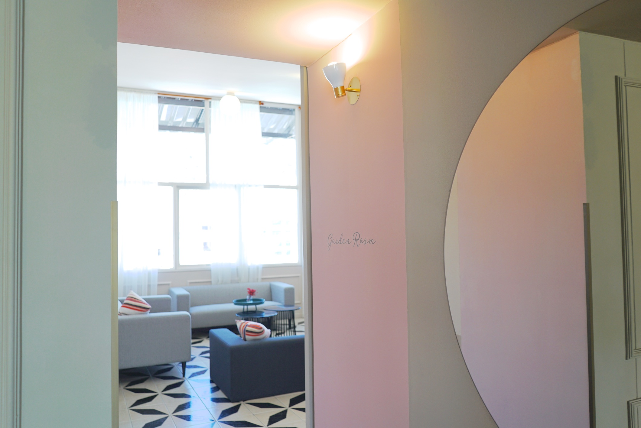 A pale pink and green entryway leads to the Garden Room.