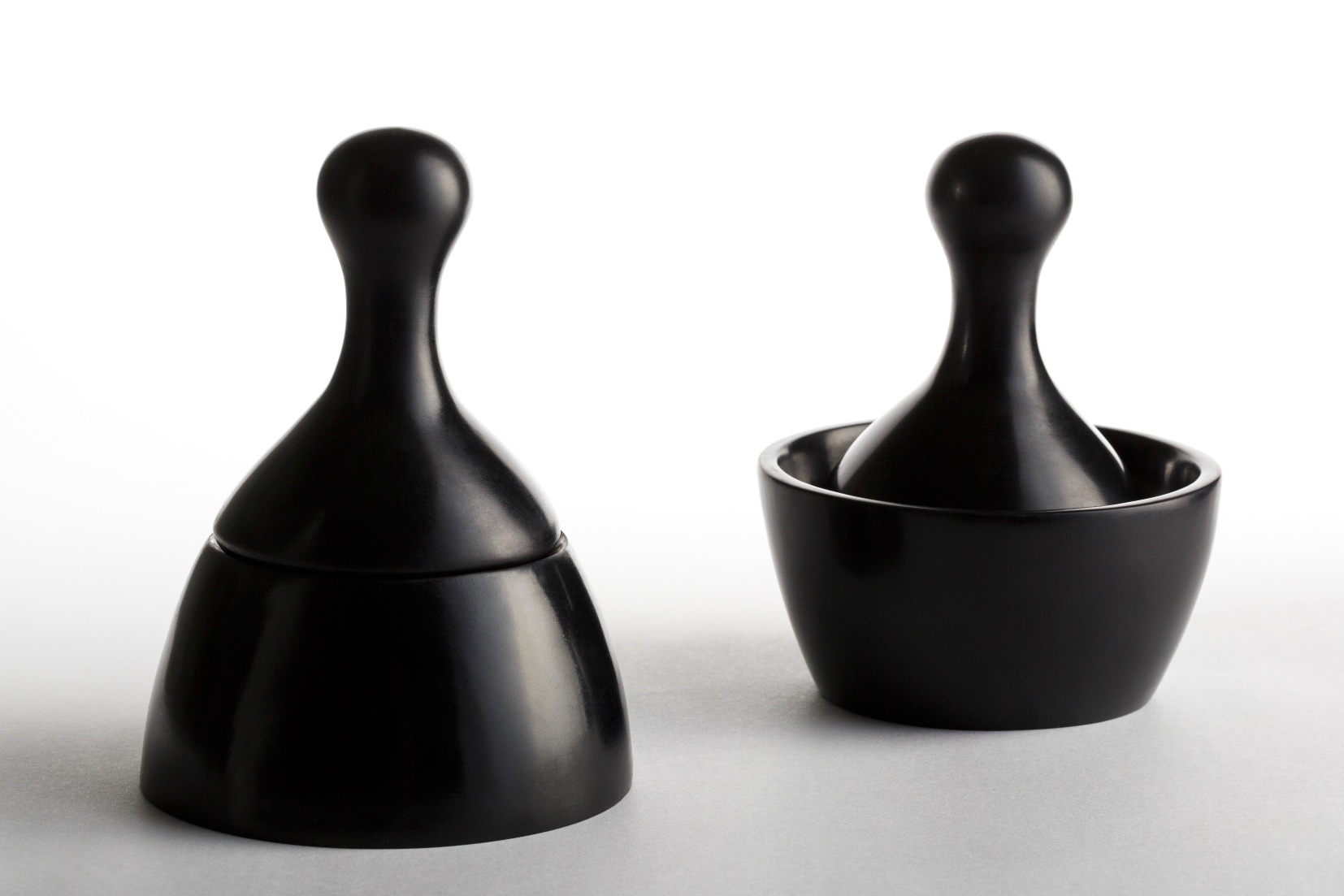 Del Valle's  Mortar & Pestle ,inspired by the smooth, rounded edges of the ancient Quimbaya relic, the  poporo , a vessel attributed with social status and mystical powers.