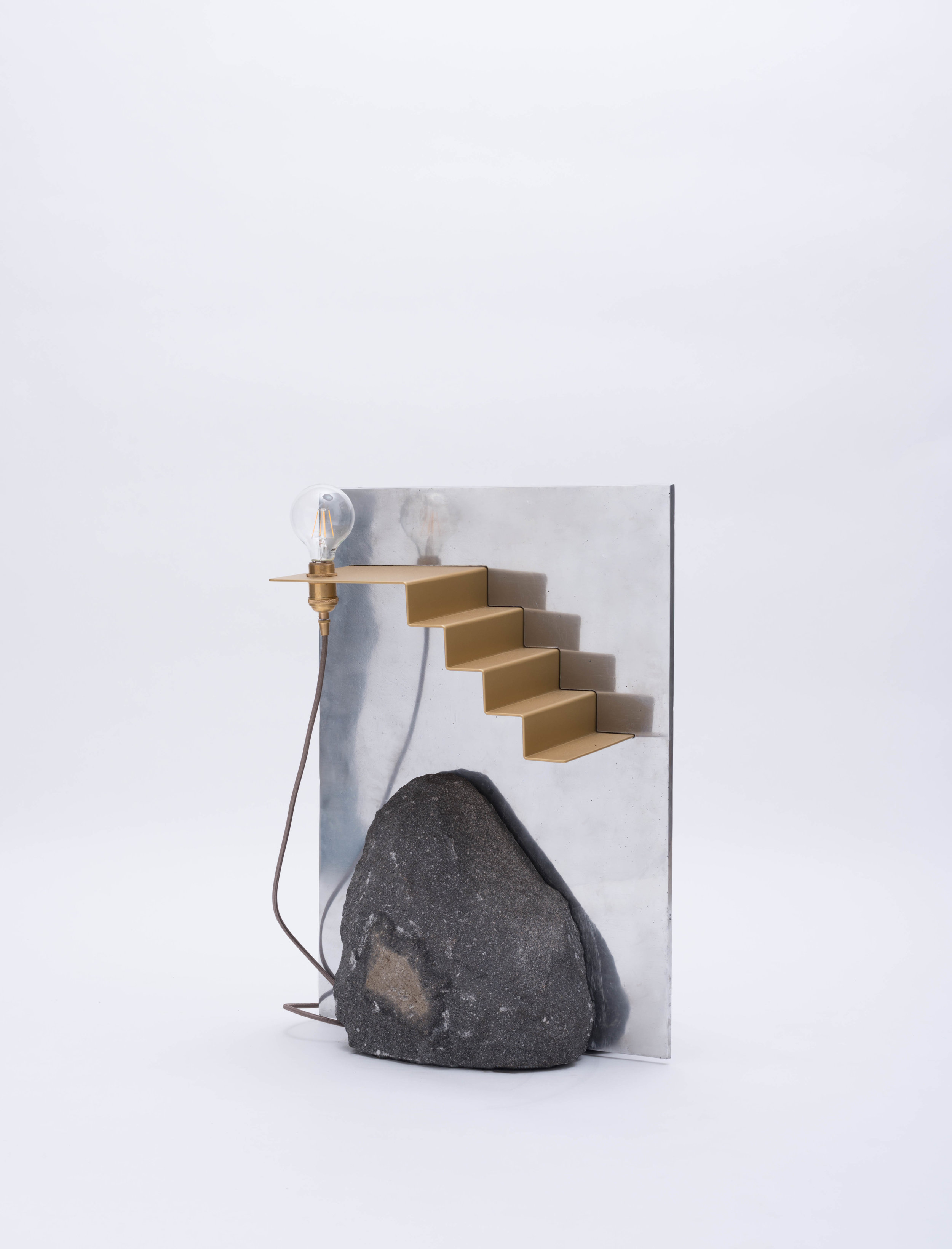 Montaña/ Pirámide Floor Lamp - Made with volcanic rock, hand-cast aluminum, powder-coated steel and brass hardware, the lamp explores the literal and symbolic representation of a mountain.