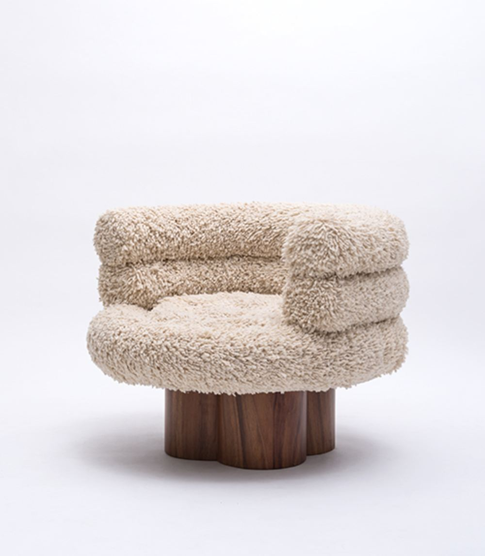 Lana Chair - Made with organic hand-woven Momostenango wool and Concaste wood. Momostenango wool is a special wool sourced from the Guatemalan highlands, typically used for rugs and tapestries. In this instance, the studio aimed to create a chair that would elevate the material as the principal element of the design.