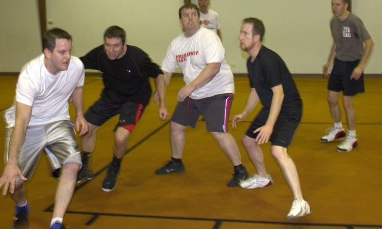"""Men's Basketball  The church basketball ministry season usually starts in October in the Activity Center. All men are invited to be a part....no matter your skill level. The season begins with """"pick-me up games"""" and then moves to organized teams and league play through April. The league runs from 6:30pm to 9:00pm.  To sign up or get more info contact  Aiden Lally"""