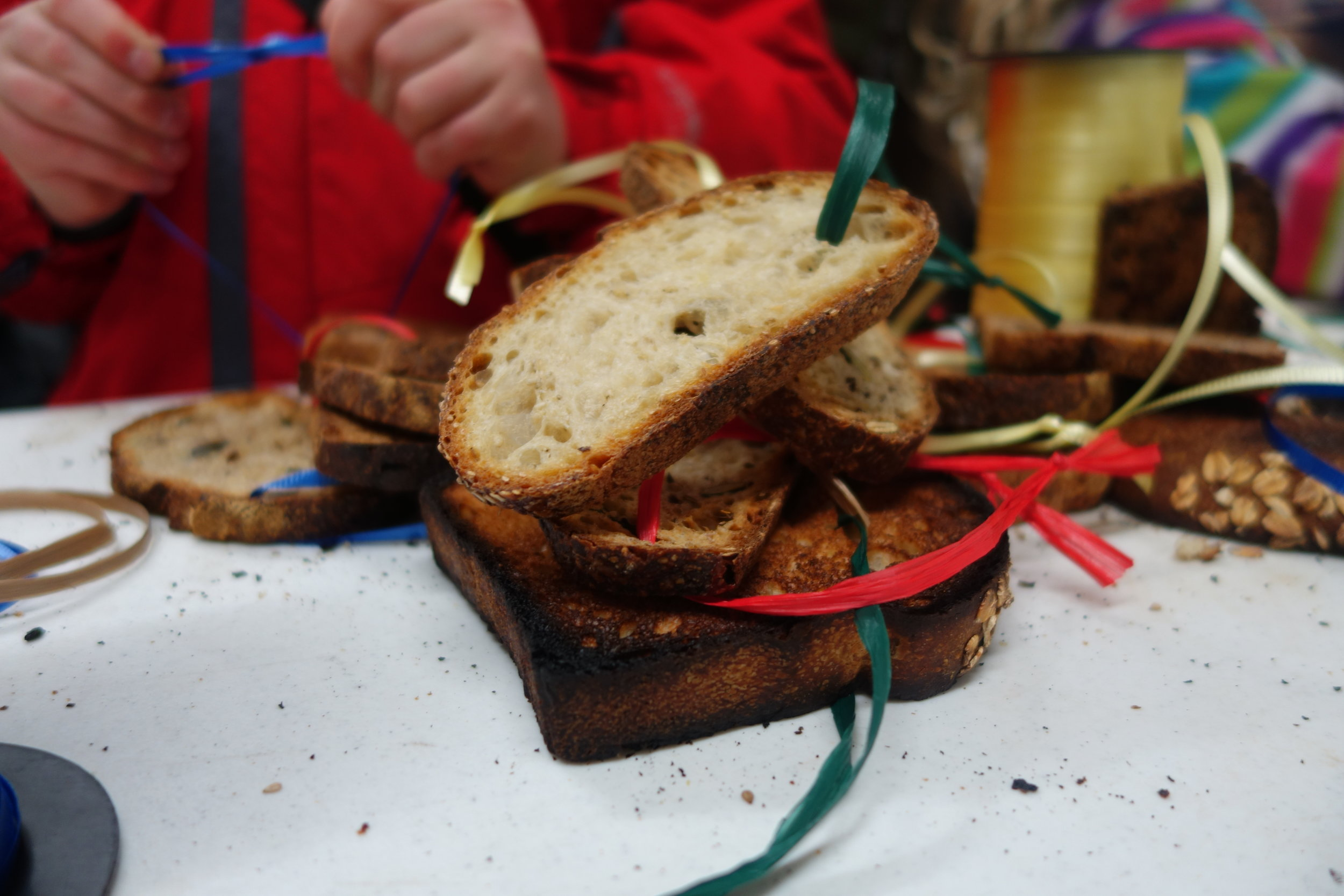 Making toast ornaments to hang on the trees
