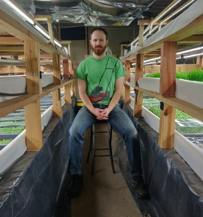 Sifted host alex trahan in his hydroponic greenhouse.jpg