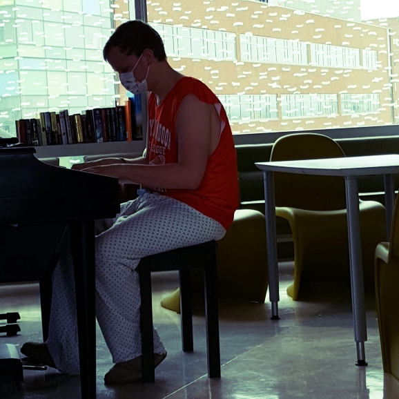 Bo playing piano at Johns Hopkins Bloomberg Center