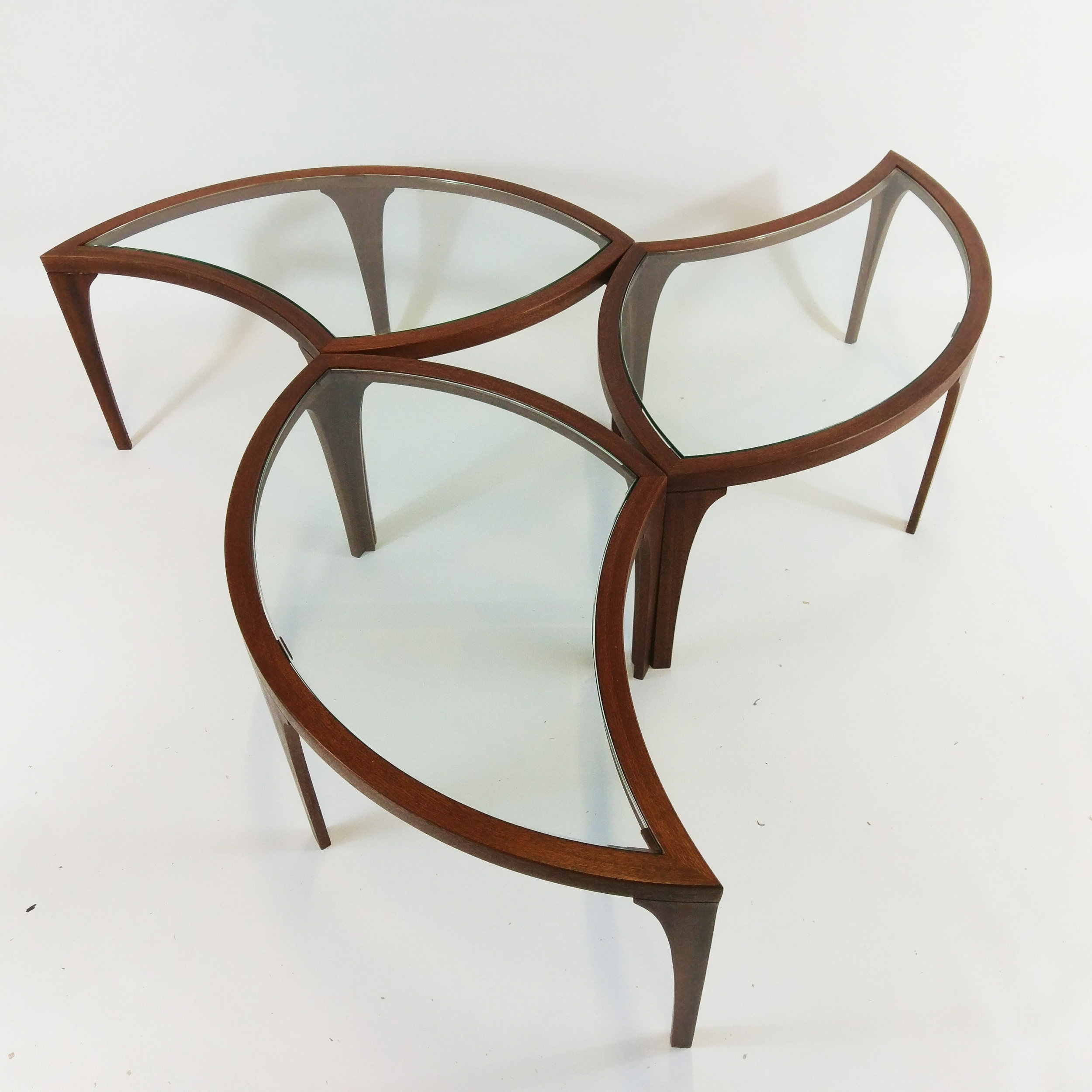 circular coffee table nest in sapele and glass