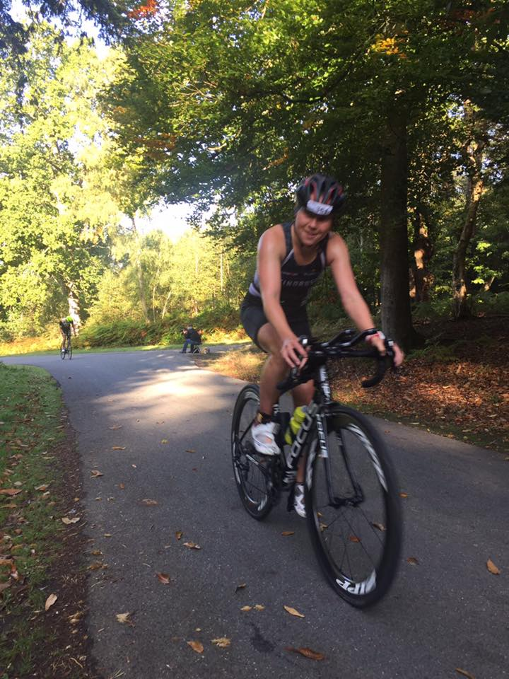 Female Windrush triathlon cycling on road