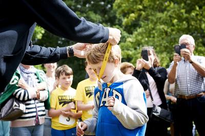 aquathlon medal being awarded to boy