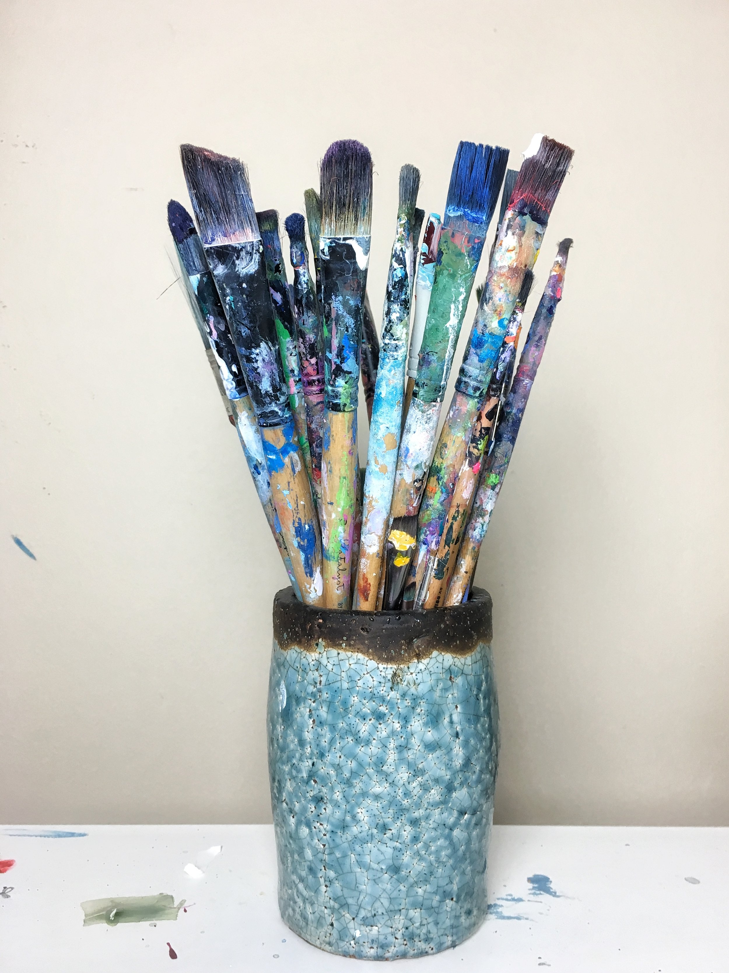 I keep my brushes in a pretty ceramic vase.