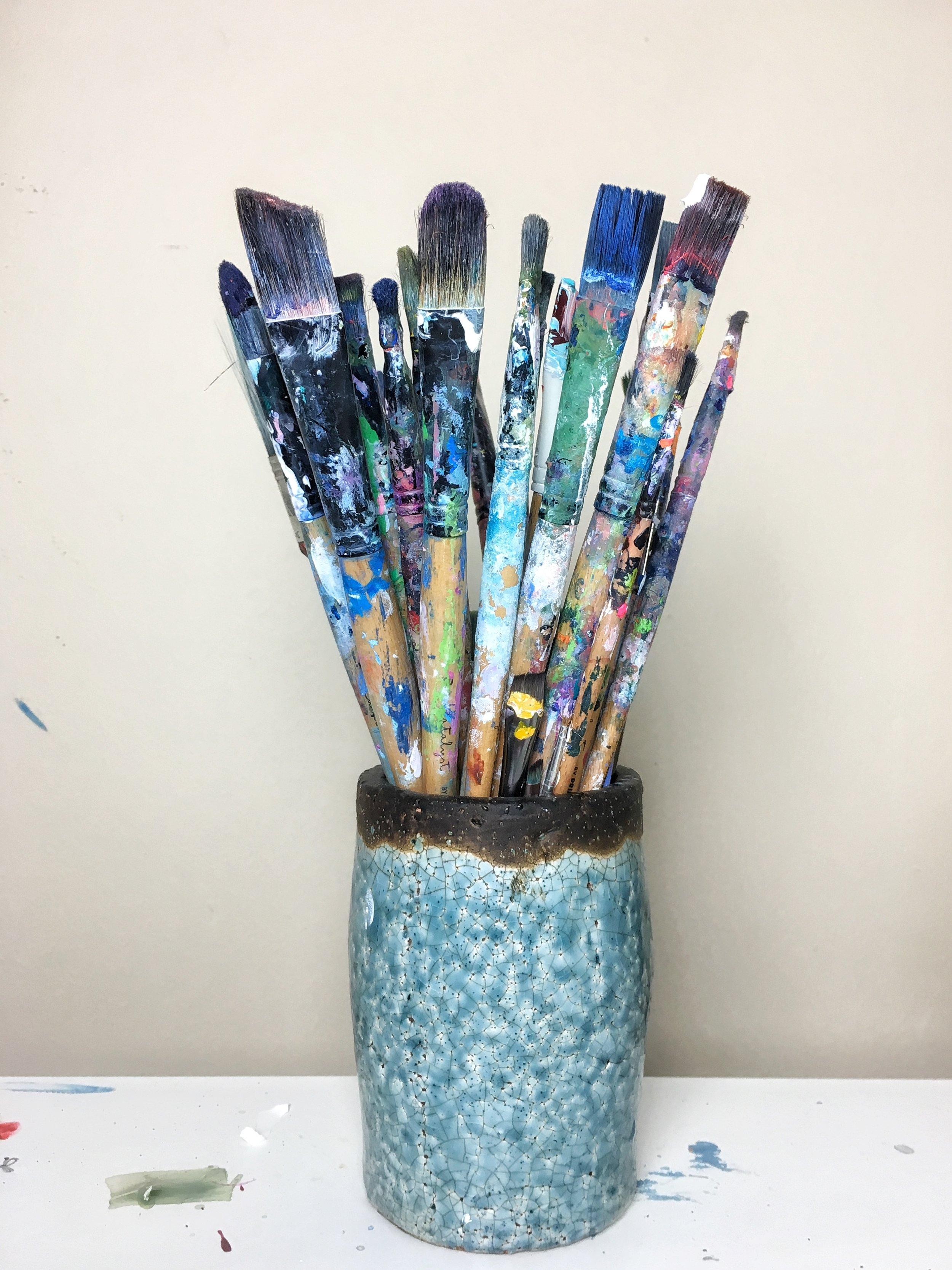 I keep my brushes in a pretty ceramic vase.