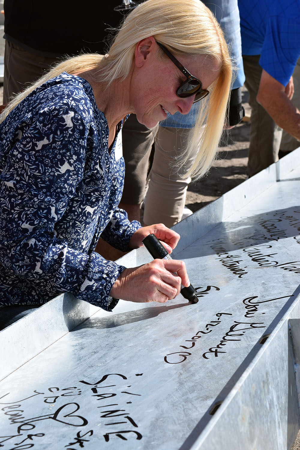 Roche Platinum club member Susan Scarth signing the beam