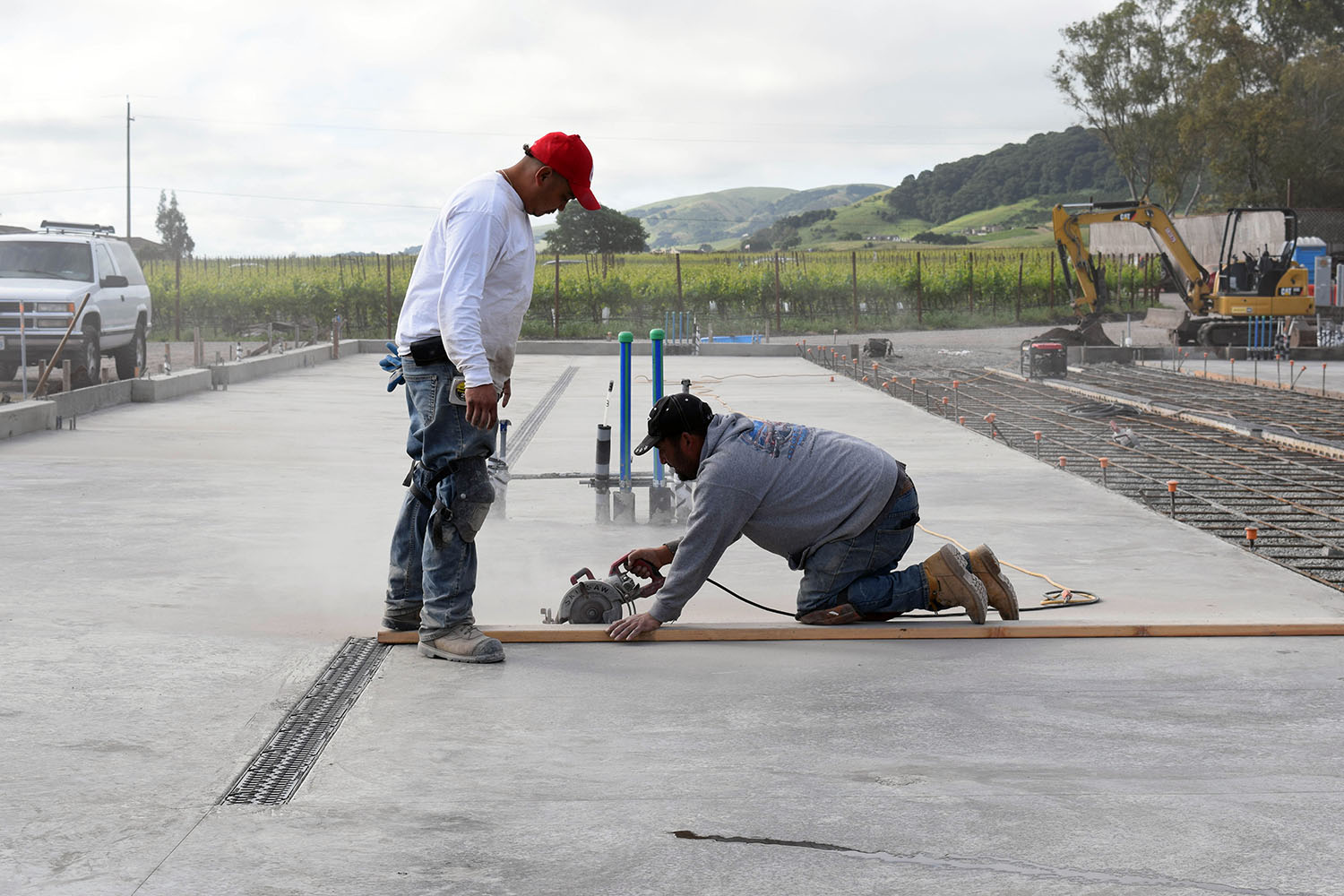 Once the slab is cured the pouring crew cut their contraction joints in the barrel building