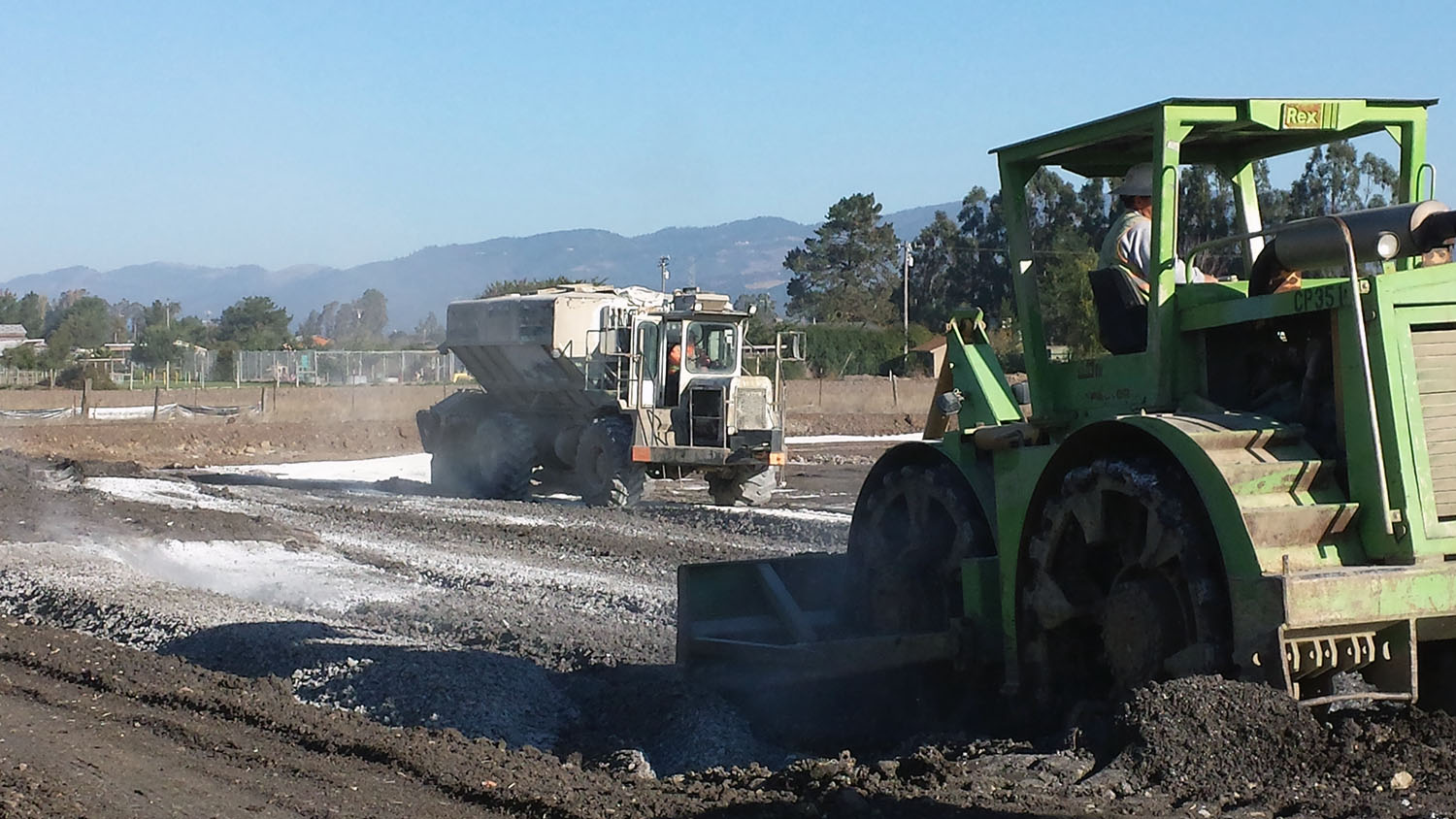 Depositing the calcium hydroxide to be mixed into these Carneros soils to allow for soil compaction
