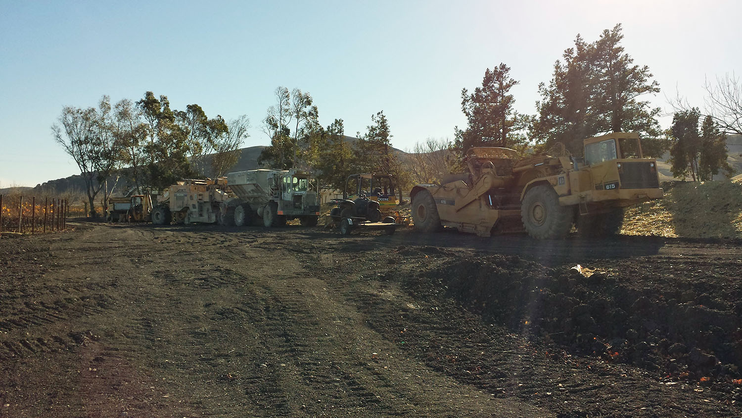 The heavy equipment at rest as the site is prepared for final compaction