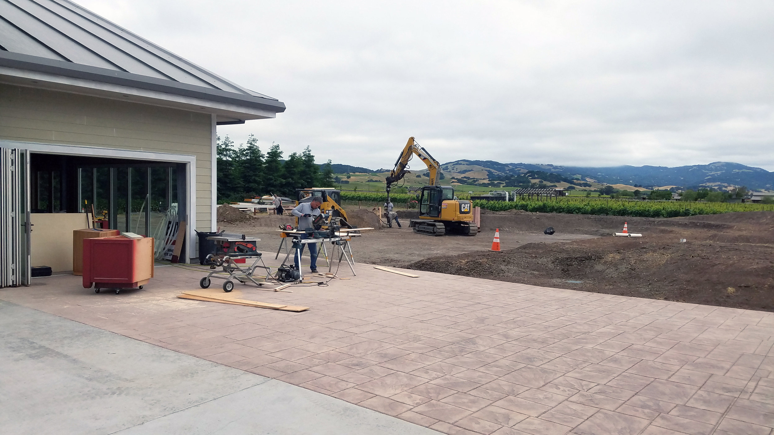Grading of the outdoor Tasting Pavilion & Plaza commences.