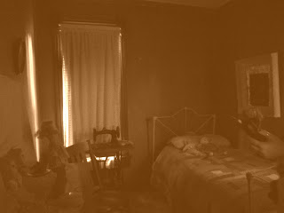 ghost on the bed in Sepia jpeg.jpg