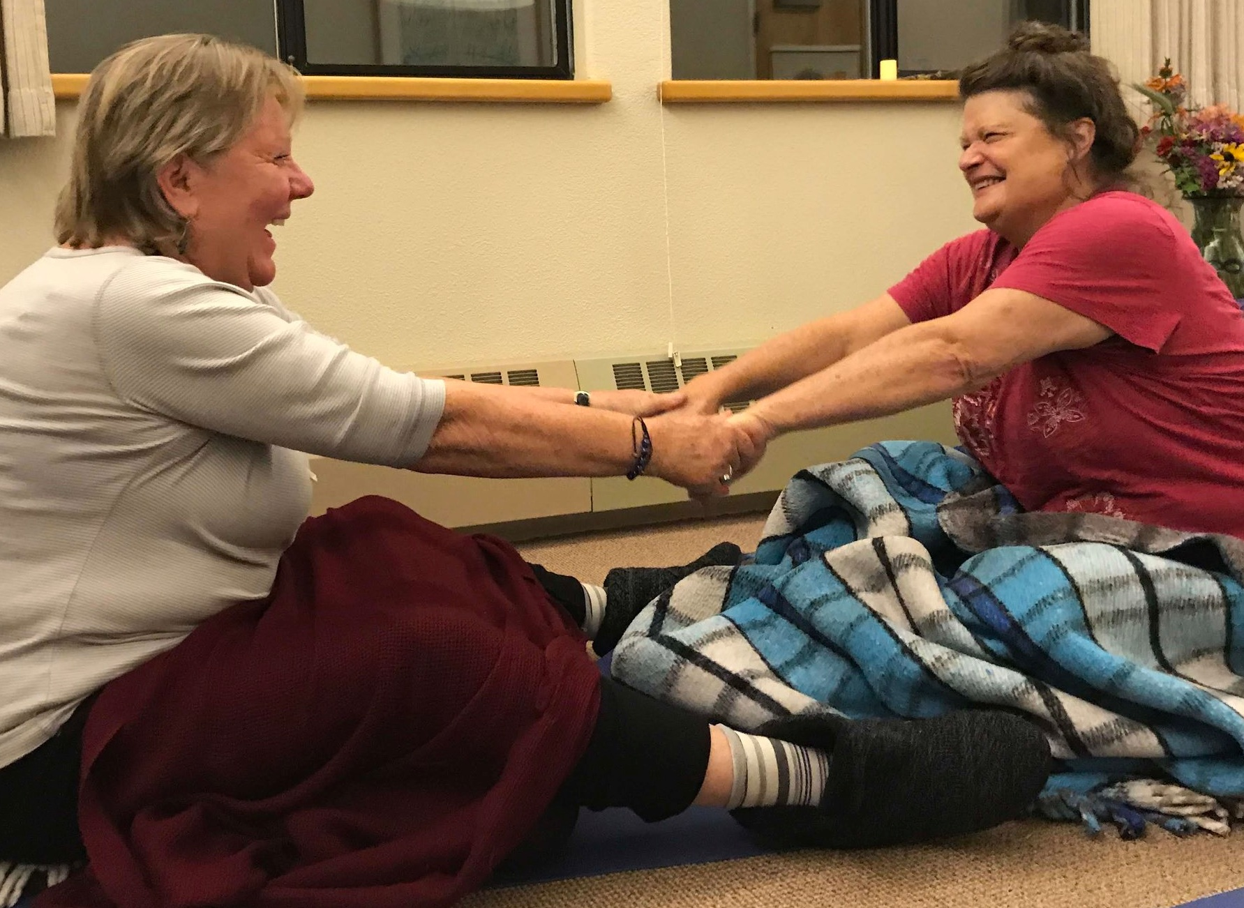 """Heidi & Elaine creating cozy bonds through Marianne's Mindful Relating Game, """"Curiosity,"""" at the Waking Up in the Wild Retreat, November 2018"""