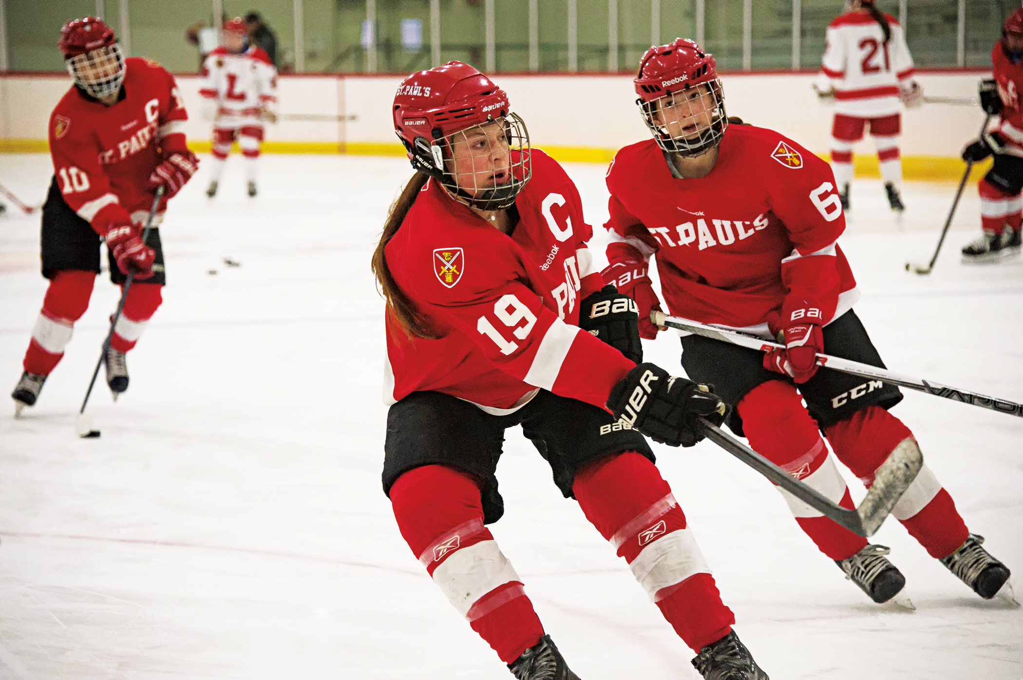 Caitlyn Wilkin '17 (l.) and Paige Galle '19 of the girls hockey team.