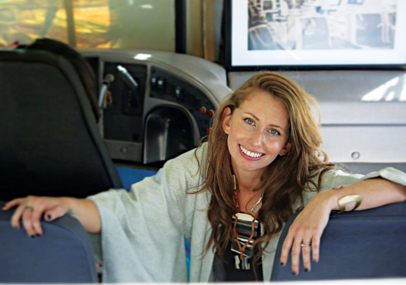 With ingenuity, vision, and creativity, Davis has created a touring art show – in a school bus. She is seen here in the newly purchased bus.