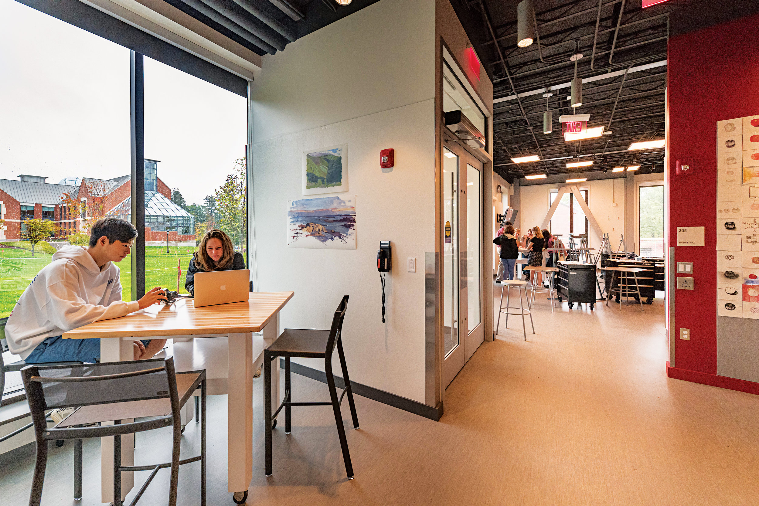 Students work in a collaborative space within the Abbé Studio.