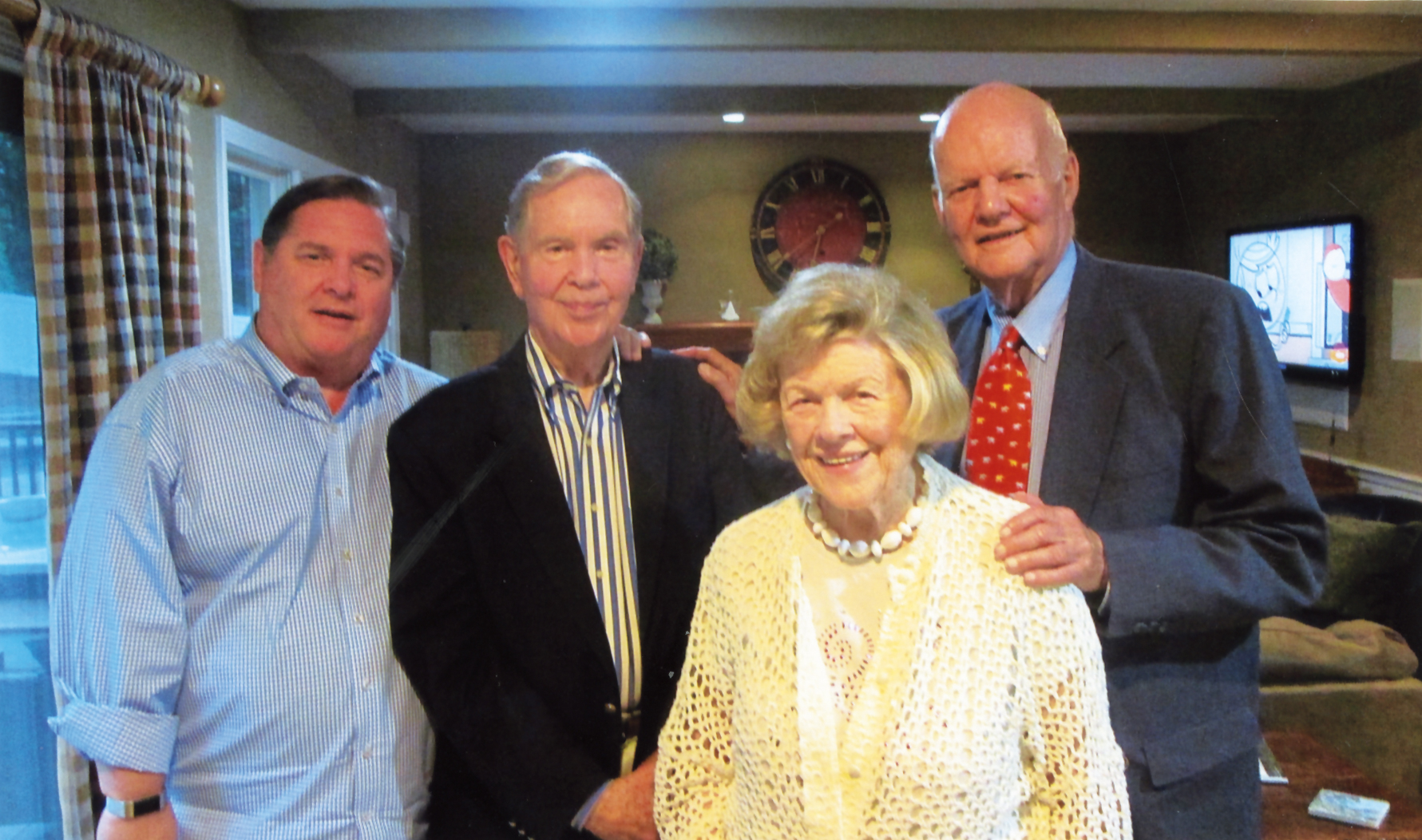 Quartie Clothier '50 celebrated his 85th birthday at his daughter's house in Hingham, Mass., with (l. to r.) Chip Clothier '75, Quartie, wife Barbara, and Dick Paine '50.