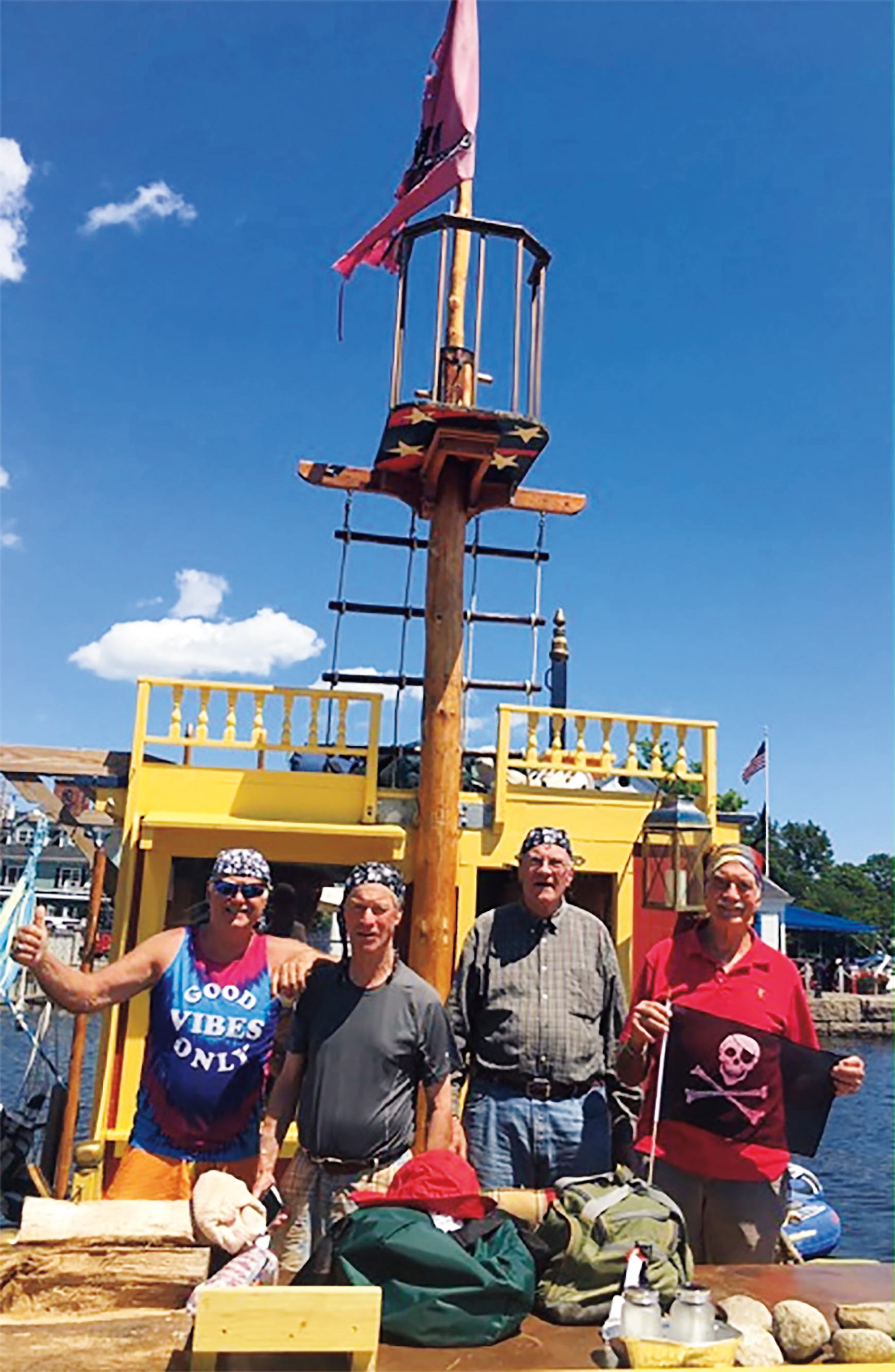 Buccaneers (l. to r.) Hunt Barclay '56, Dick Wood '56, Harald Paumgarten '56, and Bob Ingersoll '56 prepare to weigh anchor on Lake Winnipesaukee aboard Hunt's fearsome pirate ship.