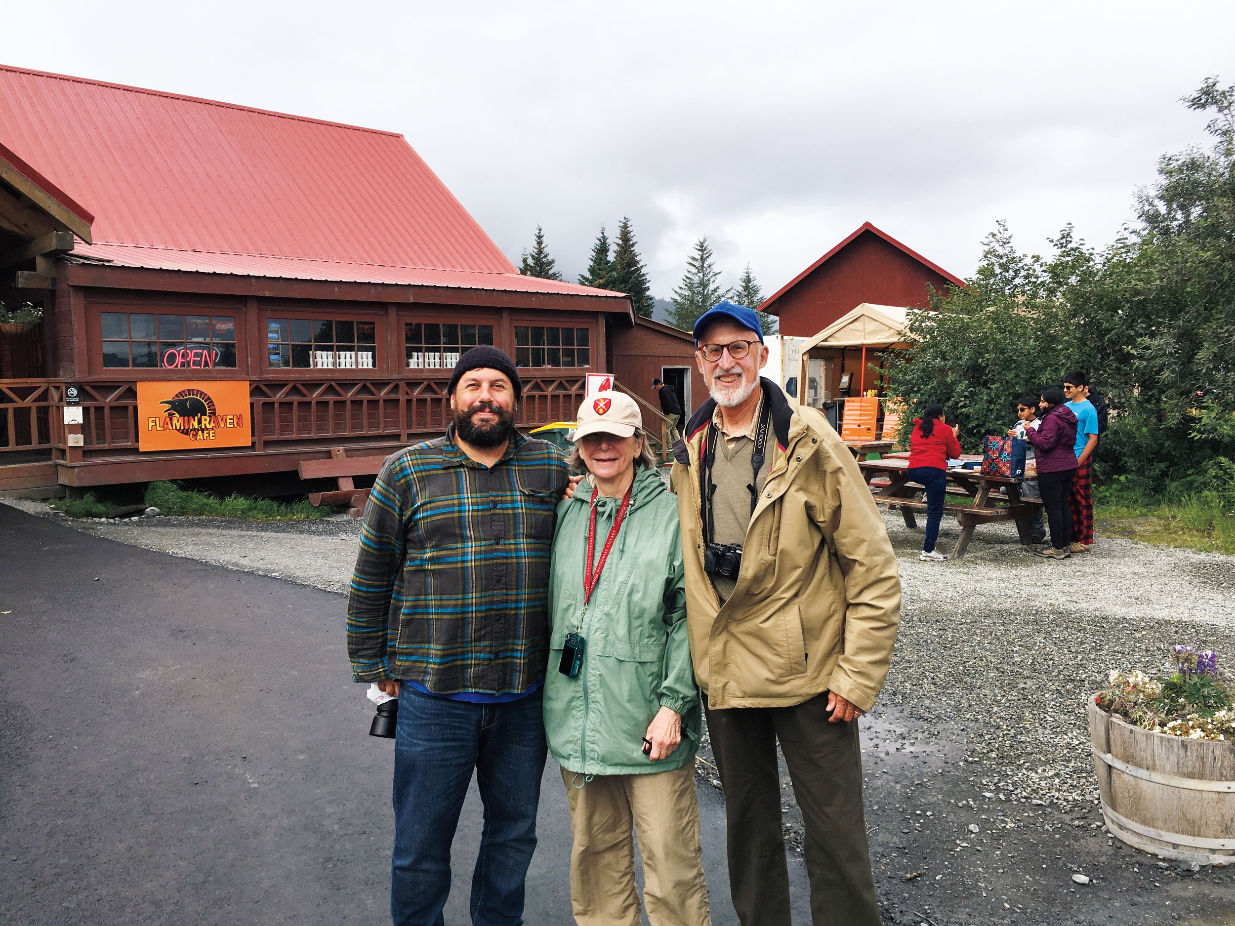 Geoff DeVito '95 (l.) recognized Jay Hatch '58 and his wife, Marolyn (center), in Alaska because of Jay's SPS hat.