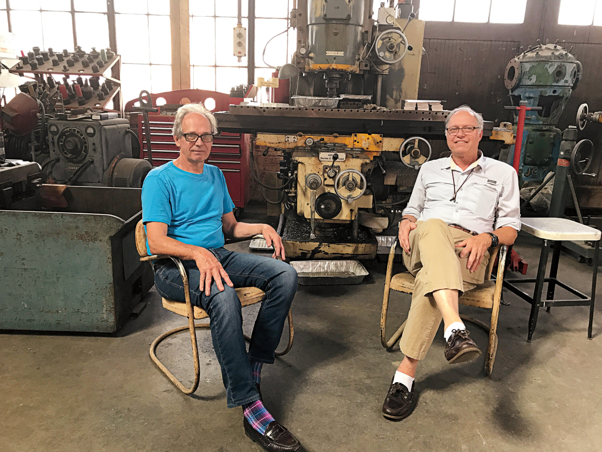 Roy Thurston '68 (l.) with Tom Shortall '68 at Roy's studio in Los Angeles.