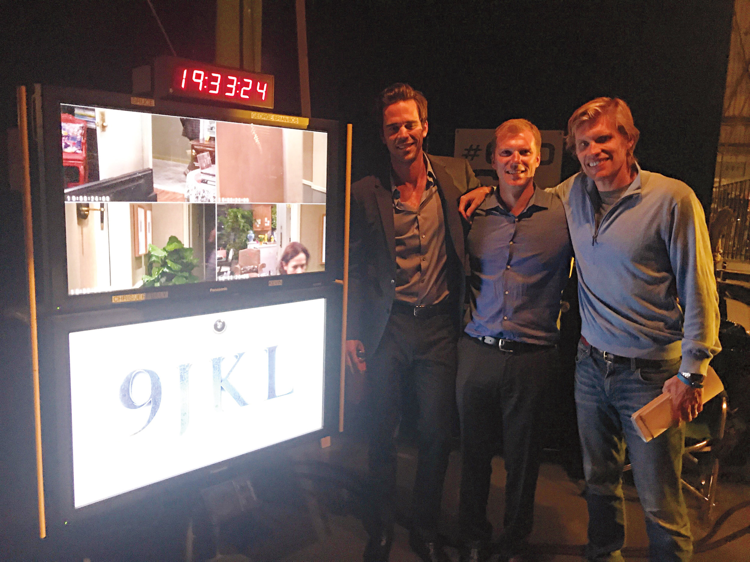 Formmates (l. to r.) David Walton '97, Jamie Funk '97, and Austen Earl '97 on the set of the new CBS comedy  9JKL .