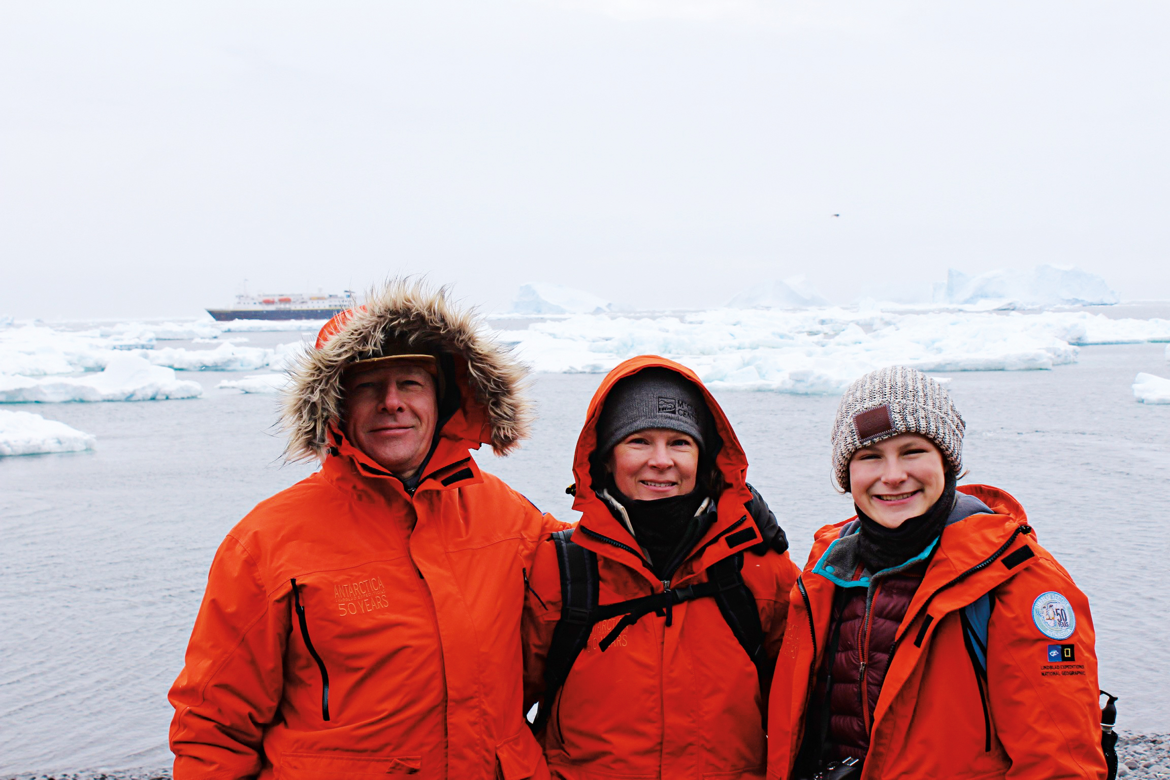 Andrew Rose '78, with wife Ann and daughter Louisa, celebrated Christmas in Antarctica, along with numerous penguins.