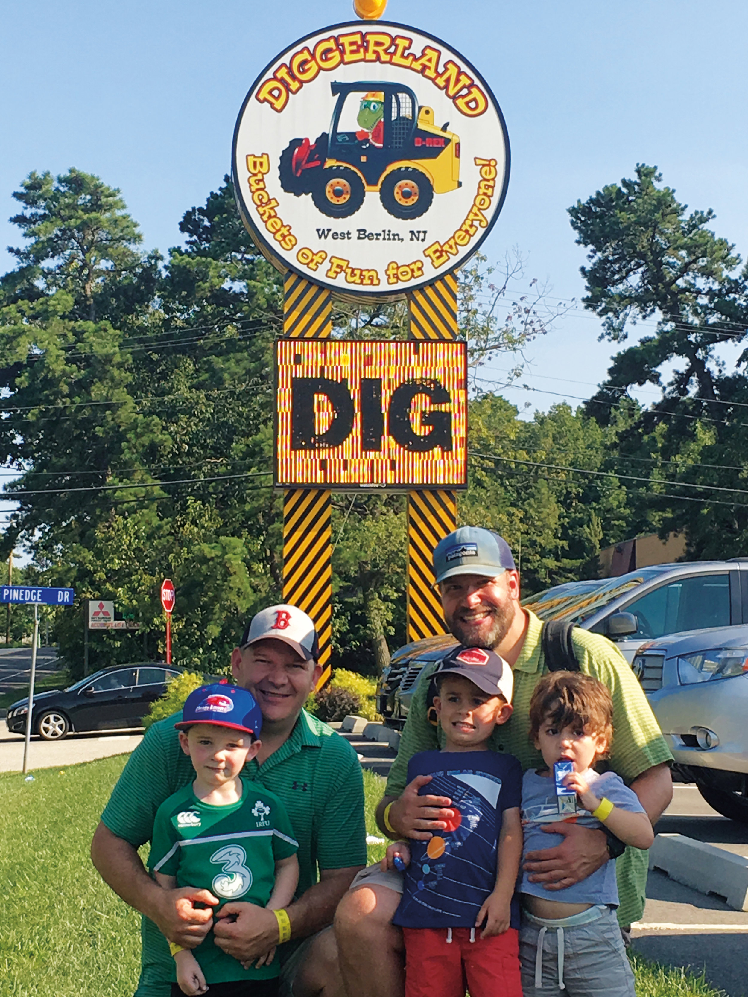 Sean Finnerty '90 (l.), with son Hugh, and Toby True '91, with sons Toby and Lincoln, spent a fun-filled day together at Diggerland (N.J.).