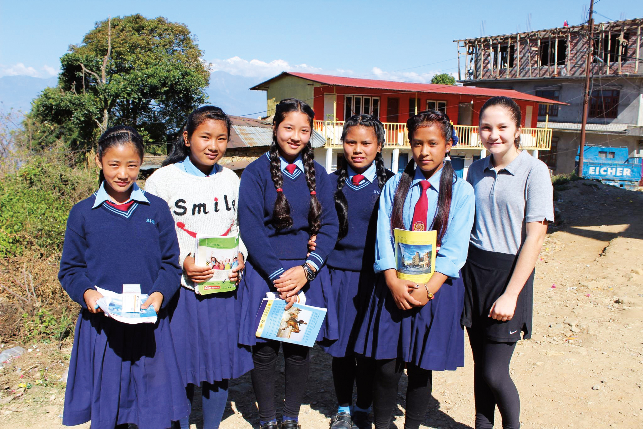 Haydn Shaw (far right, pictured with students in Nepal), daughter of Jared Shaw '92, joined her mother, Melissa, and Trevor Patzer '92 on a trip to Nepal to visit the students of the Little Sister's Fund.