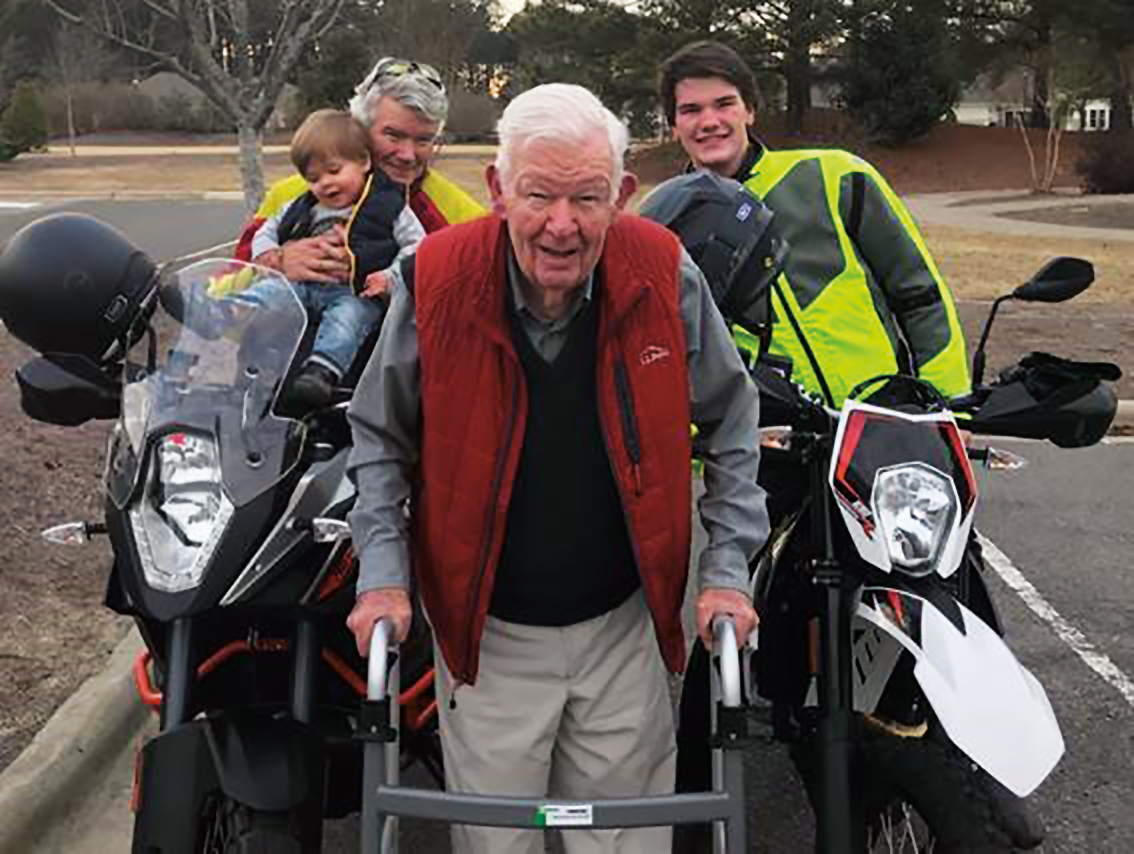 Ted Taws '52 (center) with his son, John '84 (l.), and two grandsons, ages 16 and 1 1/2.