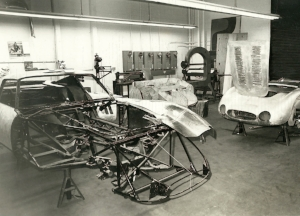 Griswold's shop in Berkeley, Calif. In the foreground is the ongoing restoration of his Ferrari 250 GTO No. 3387GT, a car first delivered and raced by Phil Hill. New aluminum parts are being made to replace race-damaged sections of the body.At right is a 1955 OSCA TN No. 1186S undergoing its body repair. The car was raced by Alejandro de Tomaso.